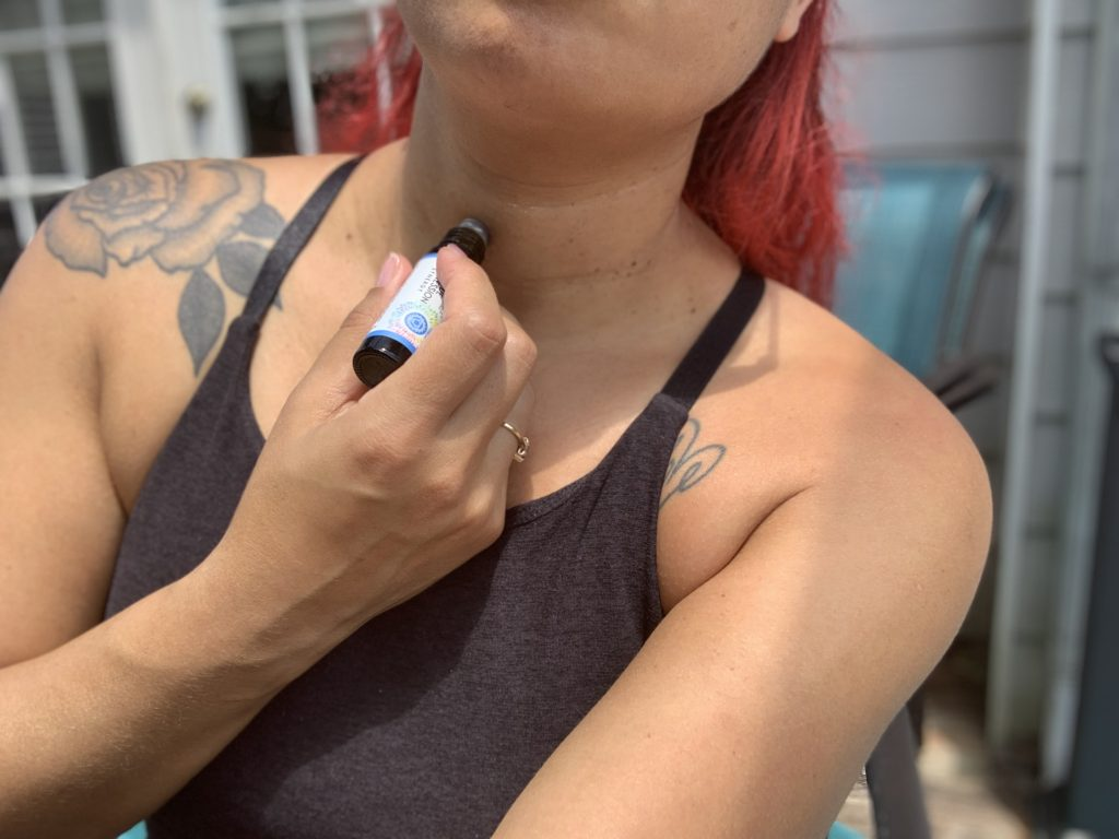 Applying essential oil to the throat chakra