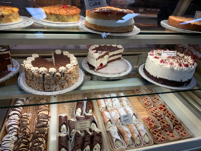 Inside Hofer's Bakery.  Cakes and cannolis.